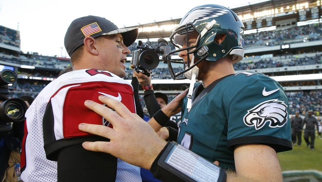 Falcons QB Matt Ryan, left and Eagles QB Carson Wentz hope to bring the first Lombardi Trophy to their respective franchises.