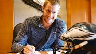 Carson Wentz, the No. 2 pick in the NFL draft, signs his contract with the Eagles on Thursday.