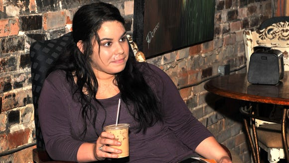 Rachel Trahan relaxes at Steam Press Cafe in downtown