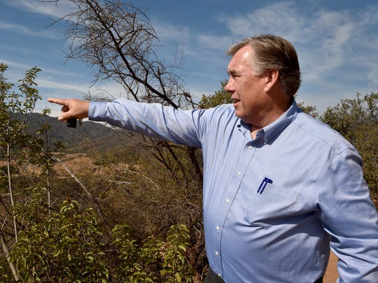 In this file photo, Steve Wickstrum, general manager for Casitas Municipal Water District, explains the history of Lake Casitas as he points out former landmarks that were previously underwater. Wickstrum is retiring Aug. 31.