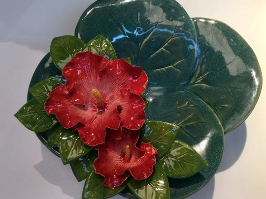 This $425 ceramic hibiscus bowl by Fort Myers artist Augusta Crane is new at the Naples Botanical Garden gift shop. It's one of a collection of her works, from platters to vases, with her own amazingly realistic florals.