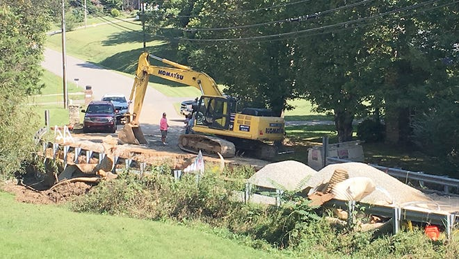 Crews continue to repair culverts under Chester Road at the intersection of Birch Bark Drive.