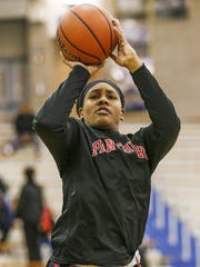 North Central Panthers' Ajanae' Thomas (34) warms up before the Panthers' game at Carmel High School on Dec. 16, 2016.