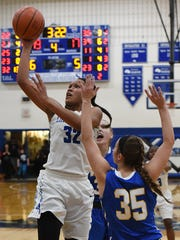 Chillicothe's Osh Brown takes a shot over a Warren