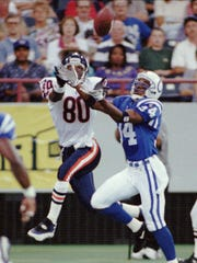 -  -Indianapolis Colts' Ray Buchanan (34) breaks up a pass in the end zone intended for Chicago Bears' Curtis Conway (80) during the first half in Indianapolis Thursday, Aug. 24, 1995. (AP Photo/Michael Conroy)