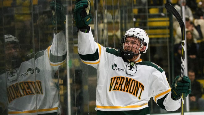 Vermont forward Ross Colton (20) celebrates after scoring a goal during the men's hockey game between the Northeastern Huskies and the Vermont Catamounts at Gutterson Fieldhouse on Feb. 16. Colton signed with the Tampa Bay Lightning and will leave the Catamounts after two seasons.