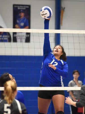 Cotter's Samantha Sanchez hits against Izard County on Tuesday night at Cotter.