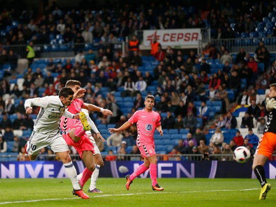 Real Madrid's James, left, scores a goal during the Spain's Copa del Rey, King's Cup soccer match between Real Madrid and Cultural Leonesa at the Santiago Bernabeu stadium in Madrid, Spain, Wednesday, Nov. 30, 2016. (AP Photo/Daniel Ochoa de Olza)