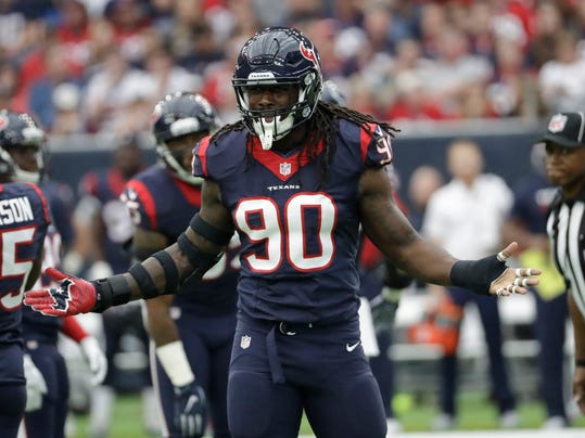 """FILE - In this Nov. 27, 2016, file photo, Houston Texans' Jadeveon Clowney gestures during the team's NFL football game against the San Diego Chargers in Houston. The Texans play the Green Bay Packers and quarterback Aaron Rodgers this week. """"It's got to be (disciplined). You can't rush past the quarterback,"""" Clowney said about rushing Rodgers. """"Keep him in the pocket. He'll make a lot of plays moving out of the back of the pocket with his legs."""" (AP Photo/David J. Phillip, File)"""