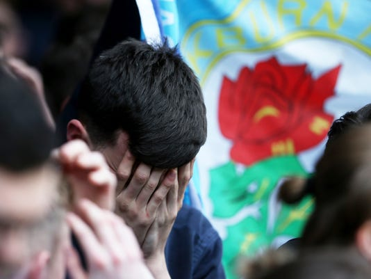 Blackburn Rovers fans are dejected after the final whistle during their English Championship soccer match against Brentford at Griffin Park, London, Sunday, May 7, 2017. Blackburn's slide down the English soccer league plunged further on Sunday when the former Premier League champion was relegated to the third tier, intensifying the club's woes under its Indian owners. (Scott Heavey/PA via AP)