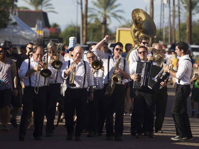 Members of a marching band perform during SanTan Brewing