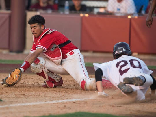 Sinton's Jonathan Carrillo slides home to score during the fifth inning of the second game of the Class 4A regional final series against Robstown Friday, June 2, 2017.