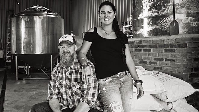Brewer and owner Brian Nentrup, and his wife, Stephanie Nentrup, pose at the Hoosier Brewing Co. production brewery in Fairland.