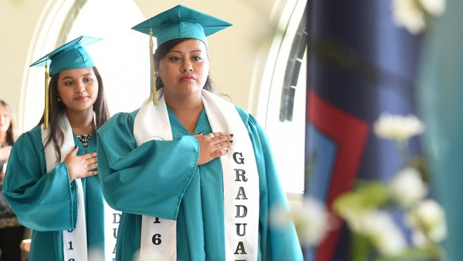 From left, Breeliant Sablan, and Jamielynn Zamora, stand proud as the Guahan Academy Charter School's first two graduating seniors at the Latte of Freedom on May 21.
