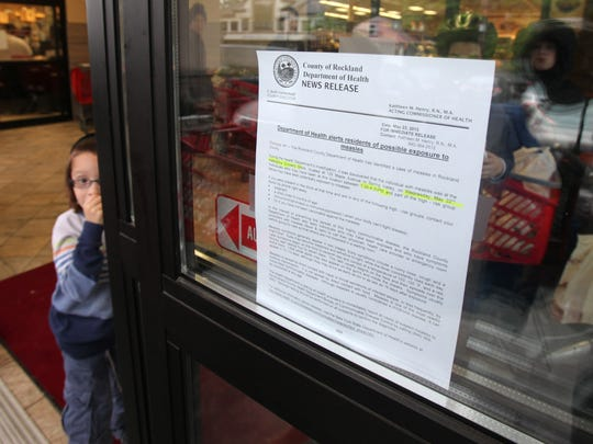 A sign on the entrance to the Hatzlacha Grocery Store in Spring Valley warns customers about a child diagnosed with measles who had been in the store in 2013. The Rockland Health Department has been working on increasing childhood vaccinations in the county.