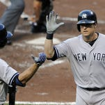 The Yankees shipped Kelly Johnson (right) to the Boston Red Sox on Thursday.
