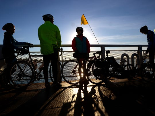 A group of bicyclists cross the north channel of the St. Clair River on the ferry Sunday, Oct. 11, during the annual fall colors bicycle tour on Harsens Island.