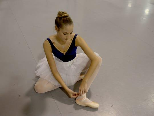 Anna Scott, 17, ties her ballet shoes at the Coupe Theatre Studio in Nanuet Dec. 5, 2017. Anna will be dancing in her 11th and final Nutcracker ballet with the Rockland Youth Dance Ensemble.