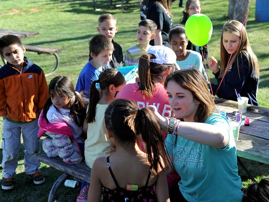 Camp Fire provide activities for  children in the camp-like setting of Harrell Park.