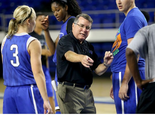 MTSU women's basketball coach Rick Insell works with freshman Abbey Sissom (3) during practice. MTSU women's basketball head coach Rick Insell works with freshman Abbey Sissom during practice as Cheyenne Parker walks behind them, at Murphy Center on Monday Oct. 6, 2014.