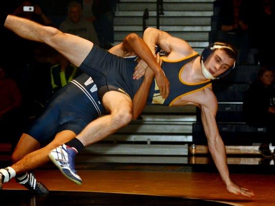 West York's Terraj DeShields takes down Eastern's Justin