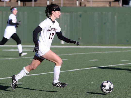 Wichita Falls High School's Alyssa Hollis dribbles