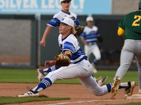 McQueen's Mason Winship stretches out to makes a catch while coving first base during recent game.