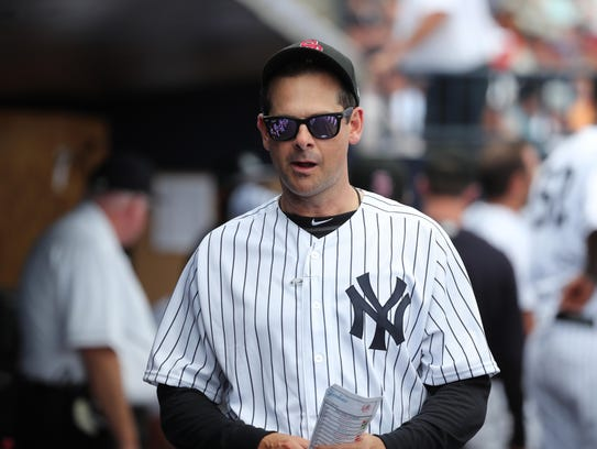 New York Yankees manager Aaron Boone (17) looks on