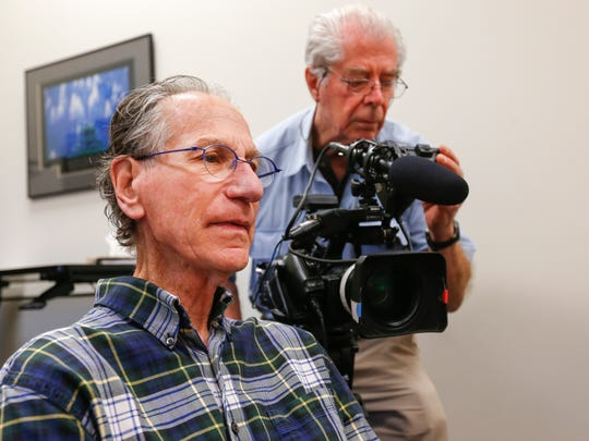 Dale Bell, left, and Harry Wiland, center, both of