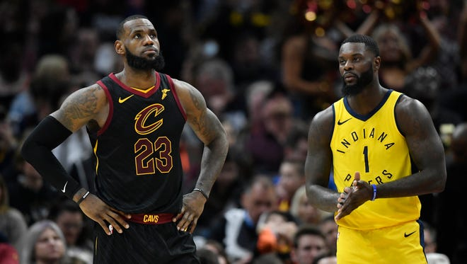 Cleveland Cavaliers forward LeBron James (23) and Indiana Pacers guard Lance Stephenson (1) in the second quarter in game one of the first round of the 2018 NBA Playoffs at Quicken Loans Arena.