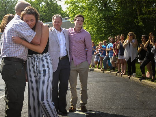 Greta Warmbier is embraced by a community member while her father Fred and older brother Austin look on  Thursday, June 15, 2017 at the Wyoming Civic Center. Hundreds of community members lined Springfield Avenue to show their support for the family and Otto Warmbier who was recently released from N. Korea, but remains in a coma.