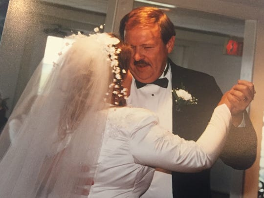 Kathy DeMoranville dances with her father, Jack Lynn,
