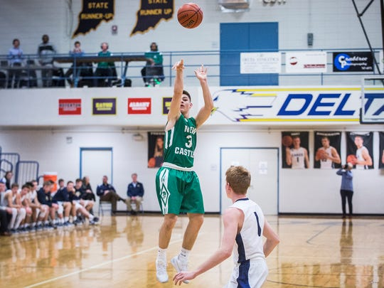 New Castle's Luke Bumbalough shoots past Delta's defense during their game at Delta High School Friday, Feb. 10, 2017.