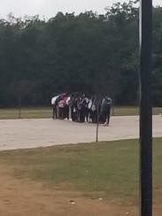 Jackson Liberty High School students protest a photo