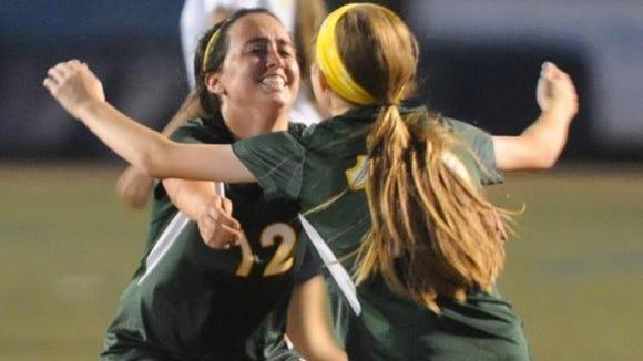Karissa Grooms, left and Megan McCallister celebrate after a goal Wednesday night.