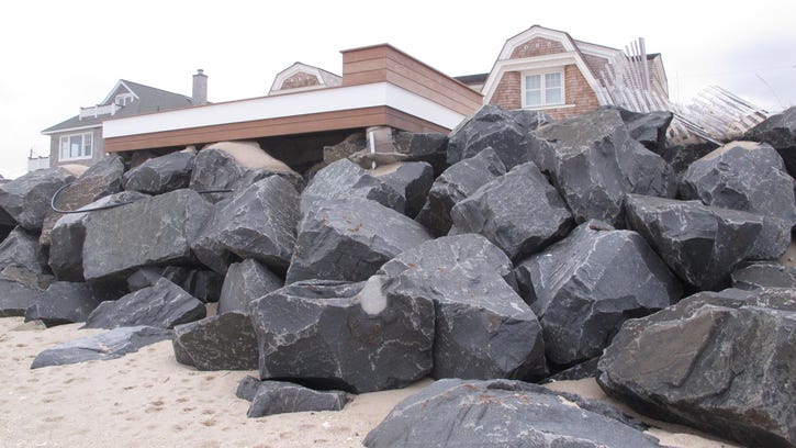 Appeals court rules against homeowners in dune case