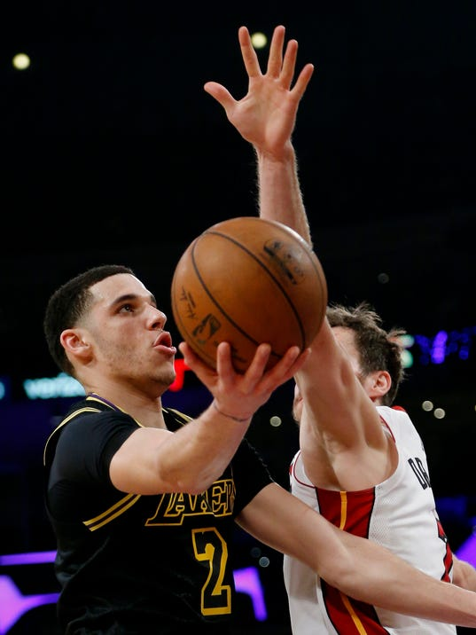 Los Angeles Lakers guard Lonzo Ball, left, goes to the basket while defended by Miami Heat guard Goran Dragic during the second half of an NBA basketball game Friday, March 16, 2018, in Los Angeles. The Heat won 92-91. (AP Photo/Ringo H.W. Chiu)