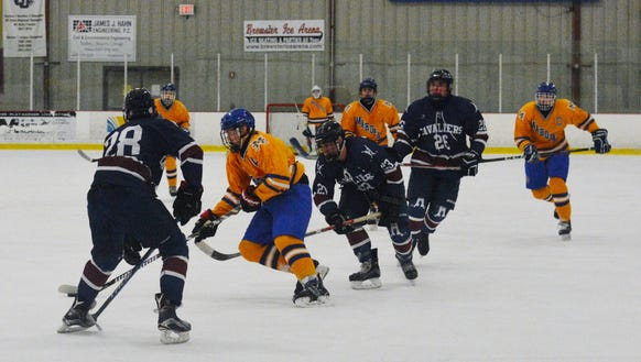 Harvey defenseman Jude Brower stops a Mahopac breakout