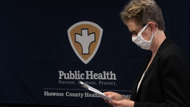 Linda Ochs, director of the Shawnee County Health Department, reviews notes before speaking at a news conference. Ochs announced her retirement on Monday's commission meeting agenda.