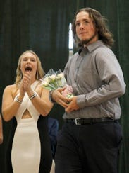 Victoria Purcell of Altoona cheers on Sam Haines after