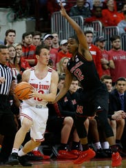 Ohio State's Andrew Dakich, left, looks for an open pass as Nebraska's Thomas Allen defends during the first half of an NCAA college basketball game Monday, Jan. 22, 2018, in Columbus, Ohio. (AP Photo/Jay LaPrete)
