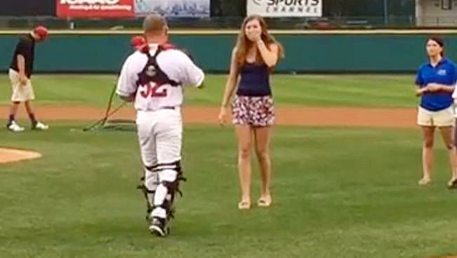 Jessica Mucci of Hilton threw out a ceremonial first pitch before the Rochester Red Wings game on Tuesday and was shocked to find her brother, Marine Cpl. Nicholas Mucci, wearing the catcher's gear.