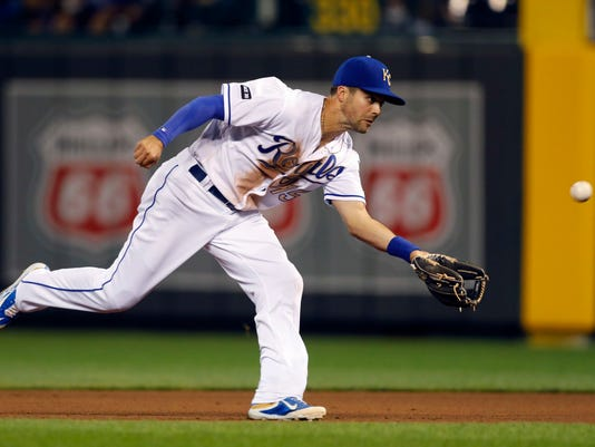 Kansas City Royals second baseman Whit Merrifield catches a pop-up from a bunt by Arizona Diamondbacks' Ketel Marte in the fifth inning of a baseball game at Kauffman Stadium in Kansas City, Mo., Friday, Sept. 29, 2017. (AP Photo/Colin E. Braley)