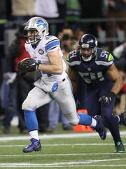 Zach Zenner runs by Seahawks linebacker Bobby Wagner during the third quarter of the Lions' 26-6 loss in the playoffs Jan. 7, 2017.