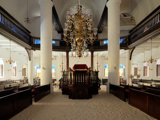 Nearly 300 years old, the Jewish place of worship has a mahogany interior, brass chandeliers and a sandy floor as a tribute to the earliest Jewish settlers who muffled their footsteps when meeting in secret during the Spanish Inquisition.