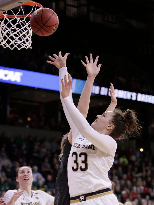FILE - In this Monday, March 26, 2018, file photo, Notre Dame forward Kathryn Westbeld (33) shoots over Oregon forward Mallory McGwire during the second half in a regional final at the NCAA women's college basketball tournament, in Spokane, Wash. About five hours after returning to Notre Dame after winning the Spokane Regiona , Kathryn Westbeld limped Tuesday into her business class at Notre Dame _ quantitative decision modeling. No one would have blamed the 6-foot-2 senior forward if she had made her way to the back of the room to find a seat and get more sleep.(AP Photo/Young Kwak, File)
