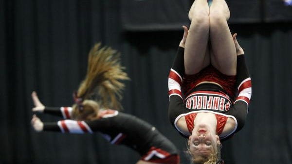 Penfield's Kayla Hewett tumbles during the Greater Rochester Cheerleading and Dance Championships at Blue Cross Arena at the Rochester Community War Memorial.