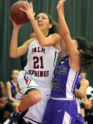 Palm Springs' Joanna Adams goes up for a shot while being defended by Shadow Hill's Alissa Munayco during the game in Palm Springs on Thursday, February 18, 2016. Palm Springs won in double overtime.