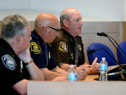 Sheriff Tim Donnellon talks about his philosophy on crime prevention during a town hall meeting with members of the community at the Port Huron Municipal Office Center Monday.