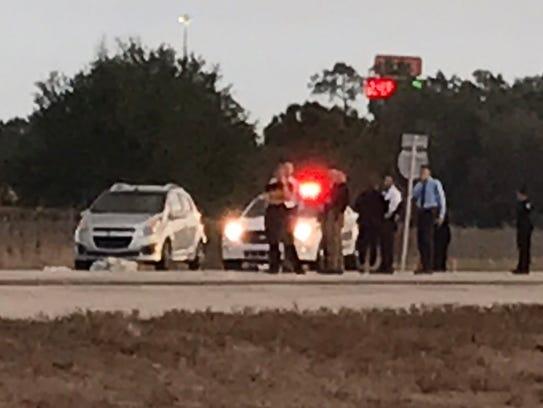 Investigators work the scene of an officer involved